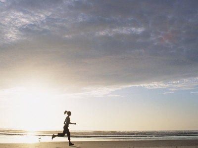 642494-FB~Woman-Running-on-Beach-at-Sunrise-Posters